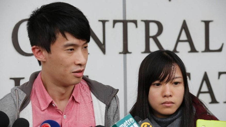 Pro-independence lawmakers Sixtus Leung, left, and Yau Wai-ching speak to the media outside a police station after being released on bail in Hong Kong, Wednesday, April 26, 2017. Hong Kong police arrested two disqualified pro-independence lawmakers over their attempts to barge into the legislature last year in a dispute over their oaths. (AP Photo/Kin Cheung)