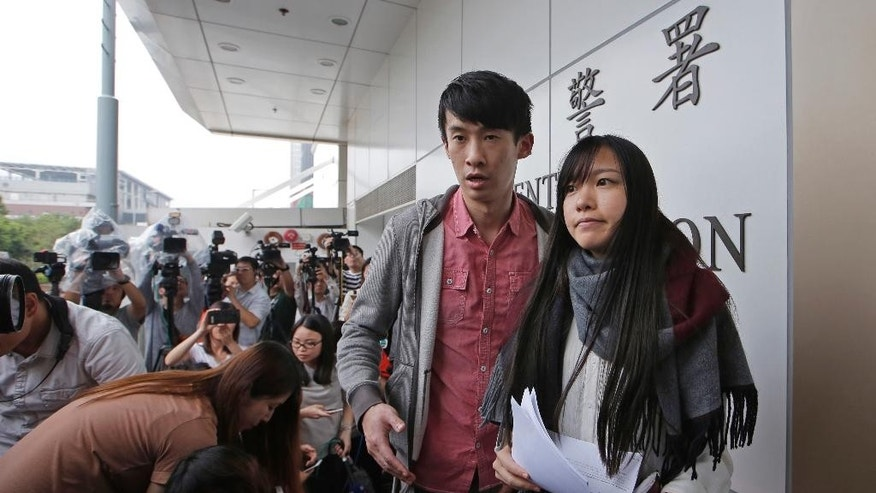 Pro-independence lawmakers Sixtus Leung and Yau Wai-ching, right, speak to the media outside a police station after being released on bail in Hong Kong, Wednesday, April 26, 2017. Hong Kong police arrested two disqualified pro-independence lawmakers over their attempts to barge into the legislature last year in a dispute over their oaths. (AP Photo/Kin Cheung)