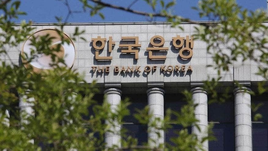 A sign for Bank of Korea is seen at its headquarters building in Seoul, South Korea, Thursday, April 27, 2017. Asia's fourth-largest economy, grew at the fastest clip in nearly a year thanks to recovery in exports, the central bank said Thursday, despite a backlash from Chinese consumers over the deployment of a U.S. missile defense system. (AP Photo/Ahn Young-joon)
