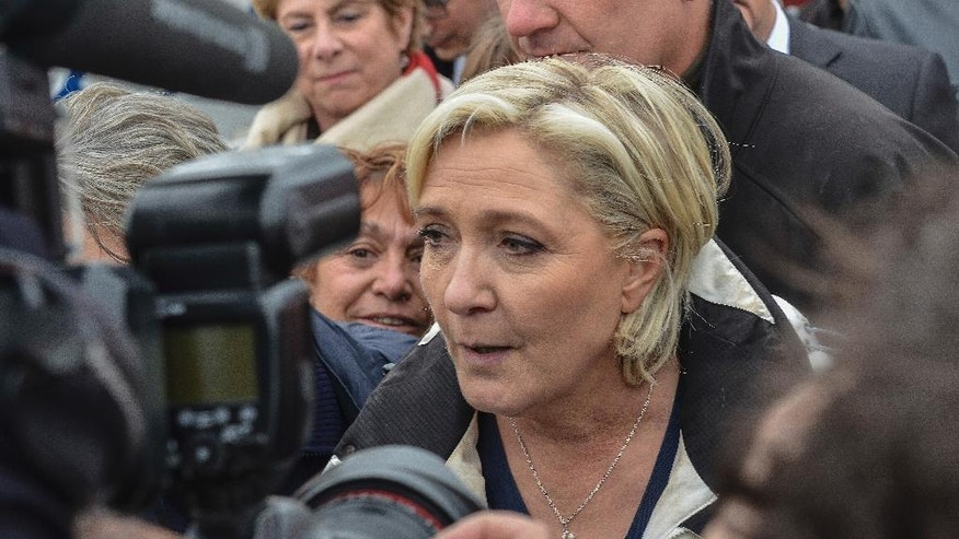 "French far-right leader and candidate for the presidential election Marine le Pen answers reporters after a sea trip in Grau-du-Roi, southern France, Thursday April 27, 2017. After ""the battle of Whirlpool,"" when Marine Le Pen and centrist candidate Emmanuel Macron both went hunting for France's blue-collar vote, the presidential candidates clashed over fish in a return to more traditional campaigning. (AP Photo/Jean-Paul Bonincontro)"
