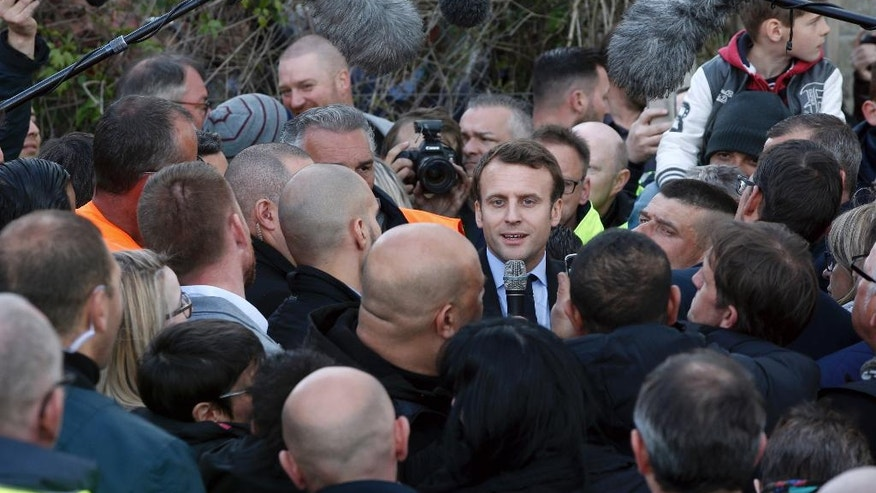French candidate Macron visits immigrant suburb
