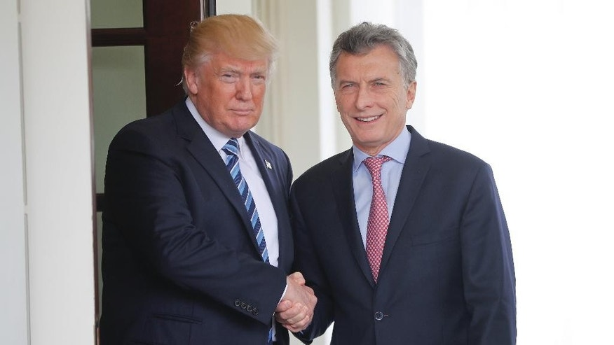 President Donald Trump shakes hands with Argentine President Mauricio Macri outside the West Wing of the White House in Washington, Thursday, April 27, 2017, following Macri's visit. (AP Photo/Pablo Martinez Monsivais)