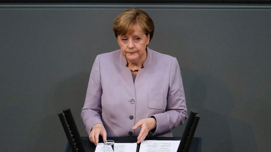 German Chancellor Angela Merkel delivers her speech about the European Union at the German parliament Bundestag in Berlin, Thursday, April 27, 2017. (AP Photo/Markus Schreiber)