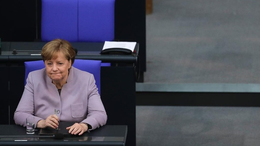 German Chancellor Angela Merkel waits for the beginning of the debate about the European Union at the German parliament Bundestag in Berlin, Thursday, April 27, 2017. (AP Photo/Markus Schreiber)