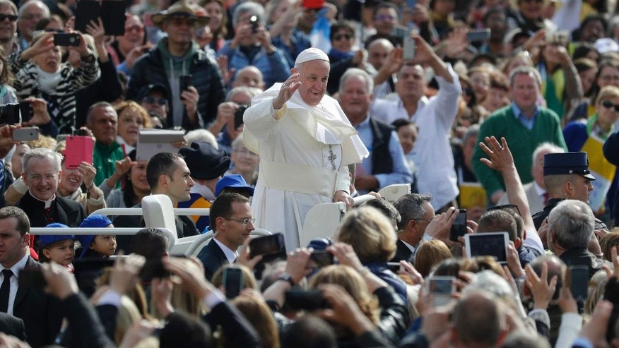 Pope Francis salutes as he arrives during his weekly general audience in St. Peter square at the Vatican, Wednesday, April 26, 2017. (AP Photo/Andrew Medichini)