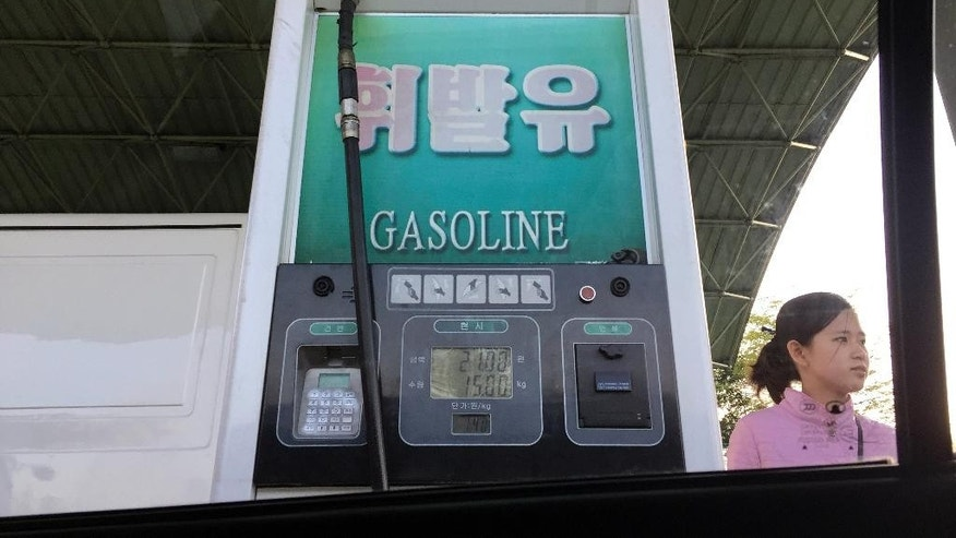 In this April 26, 2017, photo, a gas attendant waits by a pump at a gas station in Pyongyang, North Korea. Gas sales have been restricted in the North Korean capital for about a week with no official explanation, raising concerns over when the the situation will return to normal. (AP Photo/Eric Talmadge)