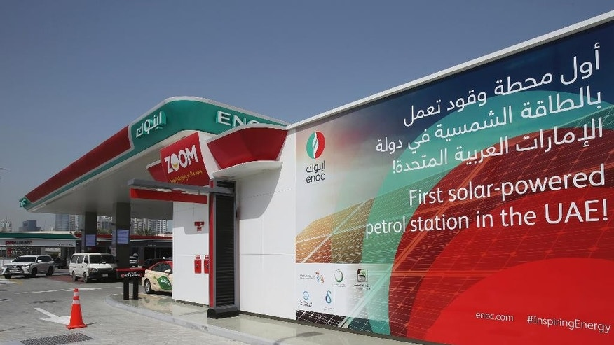 Solar panels power an Emirates National Oil Company gas station, in Dubai, United Arab Emirates, Thursday, April 27, 2017. The government-owned oil company said Wednesday the country's first solar-powered gas station in Dubai, on the city's main Sheikh Zayed Road thoroughfare, is covered with solar panels that can generate up to 120 kilowatt hours. (AP Photo/Kamran Jebreili)