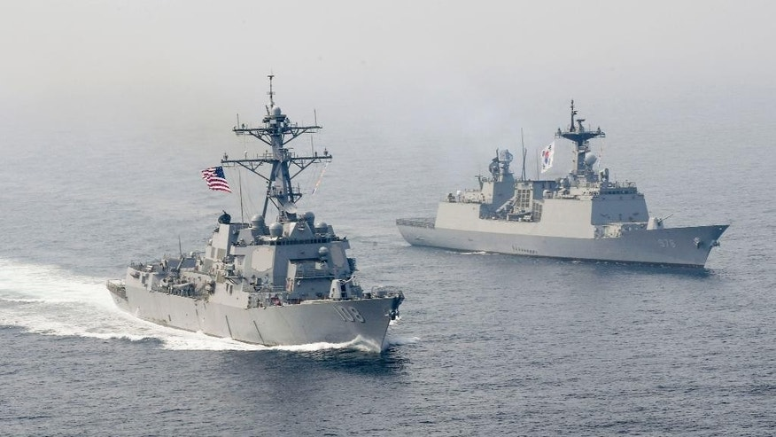 In this Tuesday, April 25, 2017 photo released by the U.S. Navy, the Arleigh Burke-class guided-missile destroyer USS Wayne E. Meyer, left, is underway alongside the Republic of Korea multirole guided-missile destroyer Wang Geon during a bilateral exercise. Wayne E. Meyer was on a scheduled western Pacific deployment with aircraft carrier USS Carl Vinson. (Mass Communication Specialist 3rd Class Kelsey L. Adams/U.S. Navy via AP)