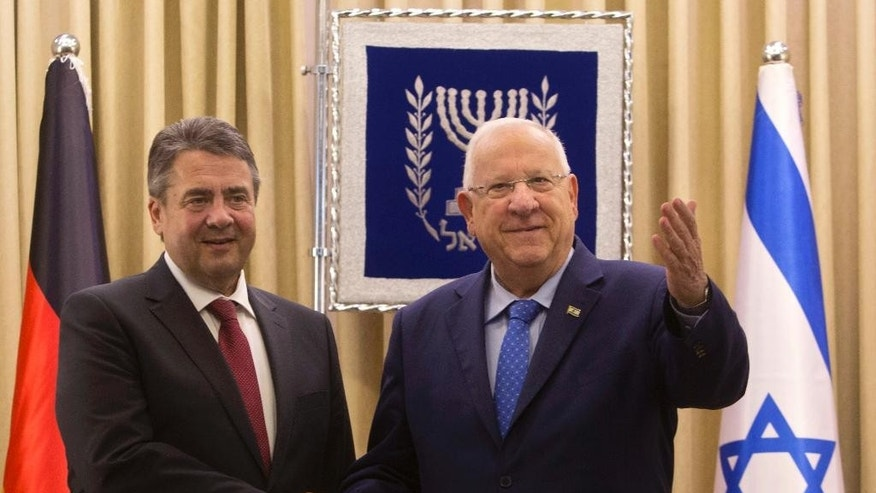 "German Foreign Minister, Sigmar Gabriel, left, shakes hands with Israel's President, Reuven Rivlin during their meeting at the President's residence in Jerusalem, Tuesday, April 25, 2017. Gabriel said Tuesday it would be ""regrettable"" if Israeli Prime Minister Benjamin Netanyahu cancels their planned talks in Jerusalem because of his meeting with groups critical of Israel's actions in the West Bank, but downplayed the spat. (AP/Sebastian Scheiner)"