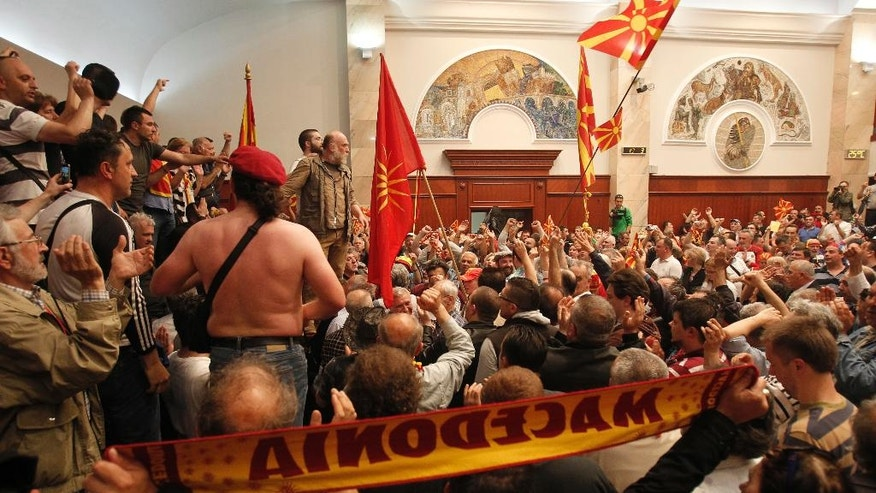 Protestors enter into the parliament building in Skopje, Macedonia, Thursday, April 27, 2017. Scores of protesters have broken through a police cordon and entered Macedonian parliament to protest the election of a new speaker despite a months-long deadlock in talks to form a new government. (AP Photo/Boris Grdanoski)