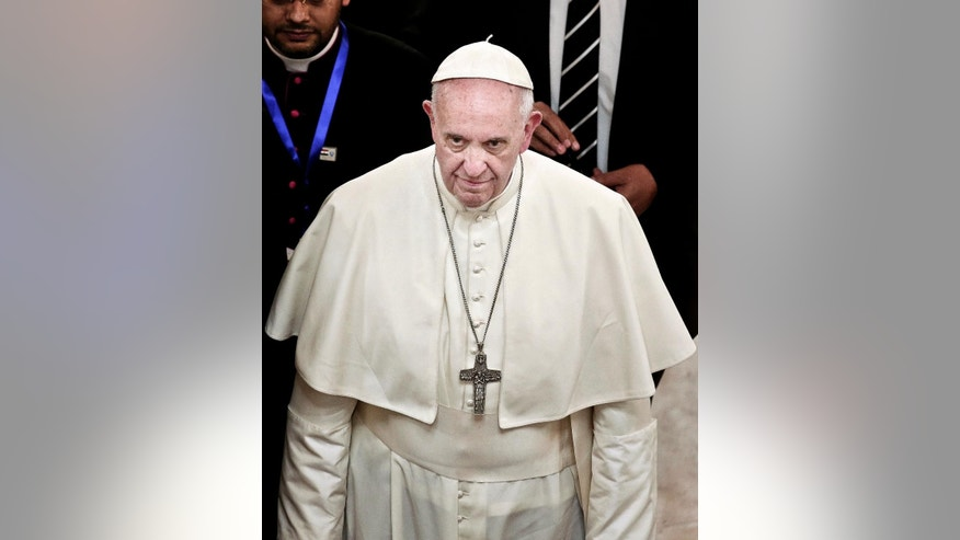 Pope Francis arrives to meet with Sheik Ahmed el-Tayyib, Grand Imam of Al-Azhar Mosque, at the al-Azhar Headquarters in Cairo, Egypt, Friday, April 28, 2017. Pope Francis came to Egypt on Friday for a historic visit to the Arab and Muslim majority nation aimed at presenting a united Christian-Muslim front to repudiate violence committed in God's name. (AP Photo/Nariman El-Mofty)