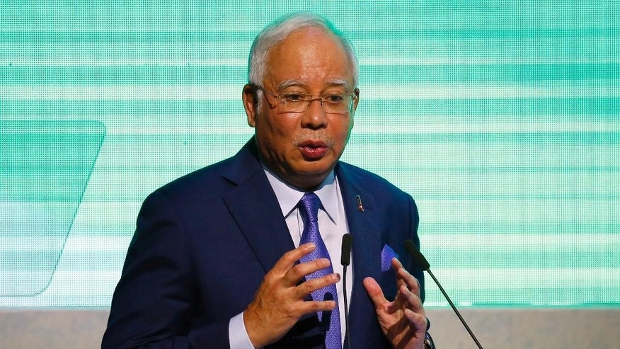 "Malaysia's Prime Minister Najib Razak addresses business leaders as he keynotes the ""Prosperity For All"" Summit, the parallel event of the 30th ASEAN Leaders' Summit Friday, April 28, 2017 in suburban Pasay city, south of Manila, Philippines. Najib is in the country to attend the annual summit of the regional grouping. (AP Photo/Bullit Marquez)"