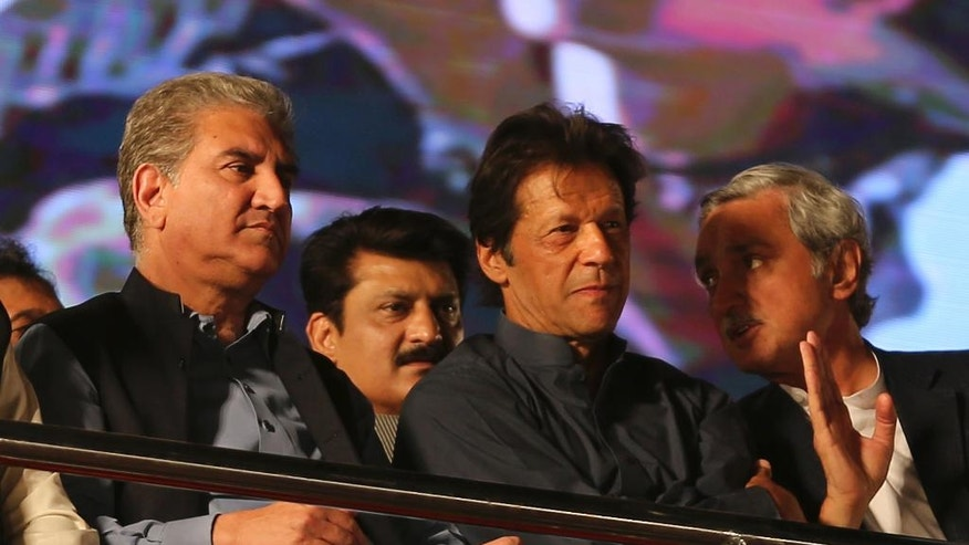 Pakistan's opposition leader Imran Khan, second from right, attends anti-government rally in Islamabad, Pakistan, Friday, April 28, 2017. Thousands of supporters of Pakistan's popular opposition leader Imran Khan have rallied in the capital, Islamabad to pressure the country's Prime Minister Nawaz Sharif to resign over his alleged corruption. (AP Photo/B.K. Bangash)