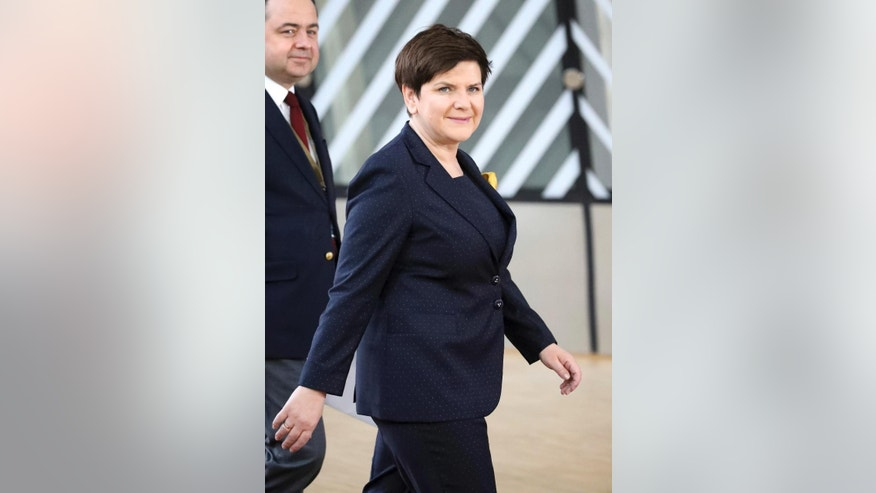 Polish Prime Minister Beata Szydto, front, arrives for an EU summit at the Europa building in Brussels, Belgium, Saturday, April 29, 2017. Following the United Kingdom's notification of withdrawal from the EU, EU leaders meet on Saturday for the first time as the formal European Council of 27 to adopt guidelines for the upcoming Brexit negotiations. (AP Photo/Olivier Matthys)
