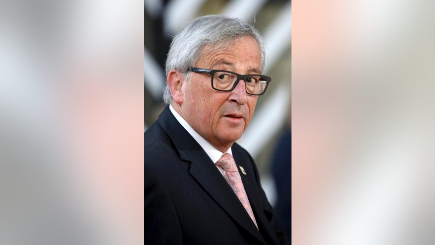 European Commission President Jean-Claude Juncker arrives for an EU summit at the Europa building in Brussels, Belgium, Saturday, April 29, 2017. Following the United Kingdom's notification of withdrawal from the EU, EU leaders meet on Saturday for the first time as the formal European Council of 27 to adopt guidelines for the upcoming Brexit negotiations. (AP Photo/Olivier Matthys)