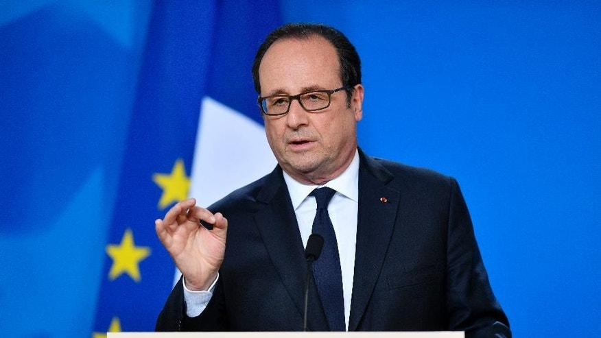 French President Francois Hollande talks to the media at a press conference after a round table meeting at an EU summit in Brussels on Saturday, April 29, 2017. EU leaders met on Saturday for the first time as the formal European Council of 27 to adopt guidelines for the upcoming Brexit negotiations. (AP Photo/Martin Meissner)