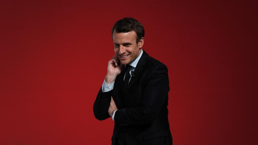 French centrist presidential candidate Emmanuel Macron delivers a speech during a campaign rally in Chatellerault, central France, Friday, April 28, 2017. Macron faces far-right presidential candidate Marine Le Pen off in a May 7 runoff election. (AP Photo/Christophe Ena)