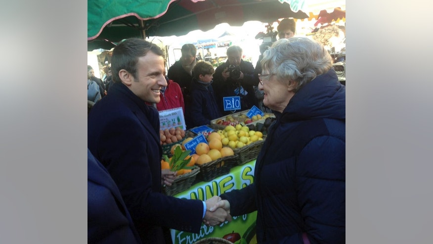 French centrist presidential candidate Emmanuel Macron visits a market in Poitiers, central France, Saturday, April 29 , 2017. Macron faces far-right presidential candidate Marine Le Pen in a May 7 runoff election. (AP Photo/Angela Charlton)