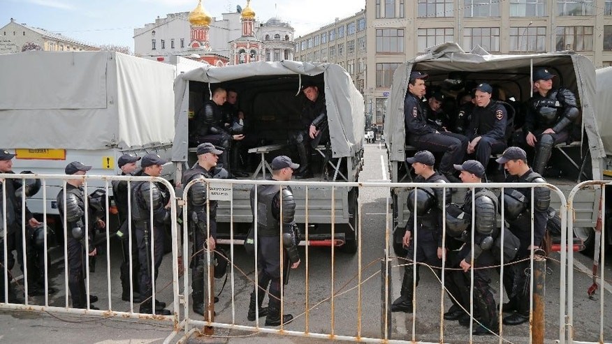 Police arrive at a square in anticipation of protests in downtown Moscow, Russia, Saturday, April 29, 2017. Regular police and riot police are positioned in central Moscow waiting for protests called for by the opposition movement Open Russia to oppose president Putin's run for the 2018 presidential elections in Russia. (AP Photo/Alexander Zemlianichenko)