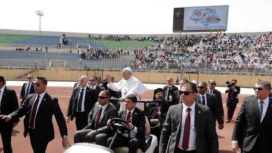 Pope Francis waves as he arrives to celebrate Mass for Egypt's tiny Catholic community, at the Air Defense Stadium in Cairo.