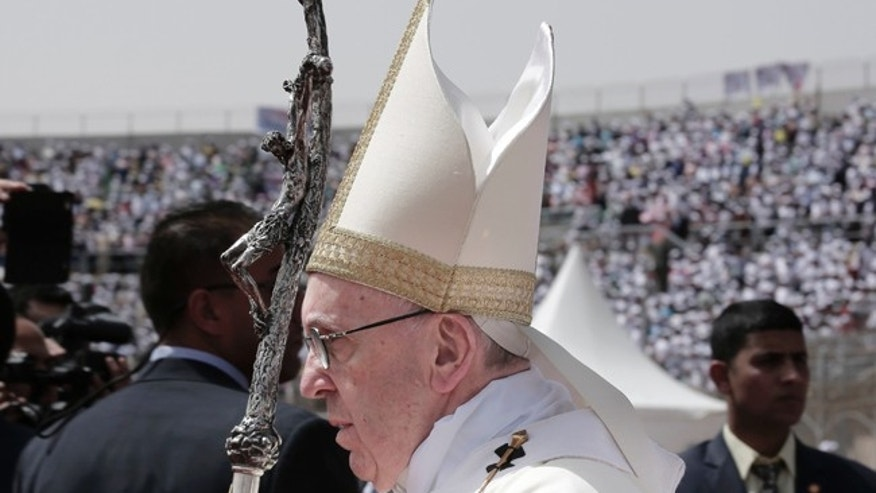 Pope Francis celebrates Mass for Egypt's tiny Catholic community, at the Air Defense Stadium in Cairo, Saturday, April 29, 2017. Pope Francis came to Egypt on Friday for a historic visit to the Arab and Muslim majority nation aimed at presenting a united Christian-Muslim front to repudiate violence committed in God's name. (AP Photo/Nariman El-Mofty)