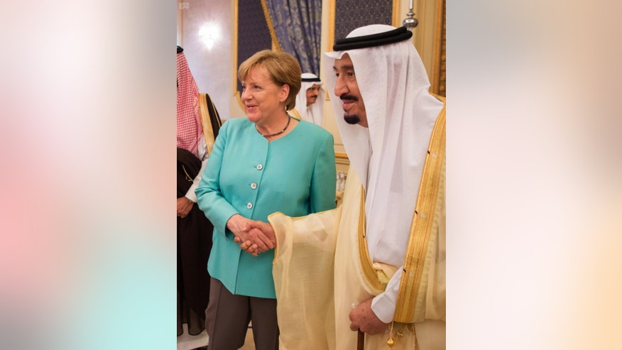 In this photo released by the Saudi Press Agency, SPA, German Chancellor Angela Merkel, left, shakes hands with Saudi King Salman on her arrival to Jiddah, Saudi Arabia, Sunday, April 30, 2017. Merkel arrived Sunday for talks with the oil-rich kingdom's monarch, beginning a two-nation trip to the Gulf. (Saudi Press Agency via AP)