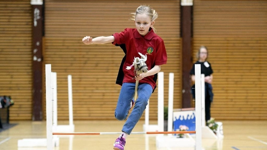 A girl competes during the hobby horsing Finnish championships in Vantaa, Finland, Saturday, April 29, 2017. (Heikki Saukkomaa/ Lehtikuva via AP)