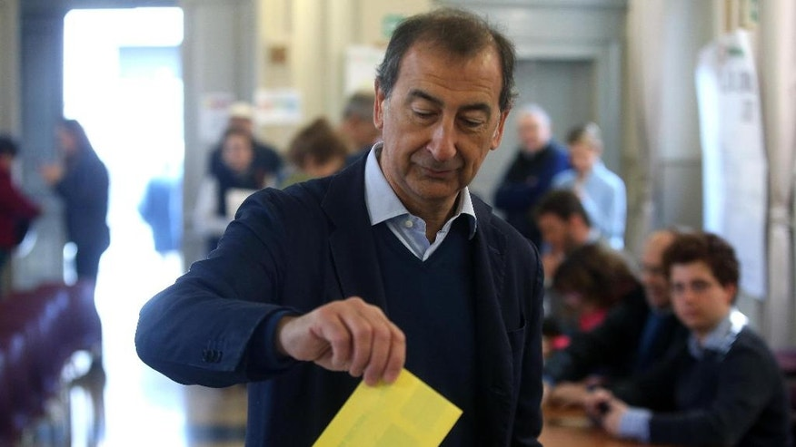 Milan Mayor Giuseppe Sala casts his ballot  for the Democratic party's primary elections, in Milan, Italy, Sunday, April 30, 2017. The three candidates are former Italian Premier Matteo Renzi, Governor of Apulia region, Michele Emiliano, and Justice Minister Andrea Orlando. (Matteo Bazzi/ANSA via AP)
