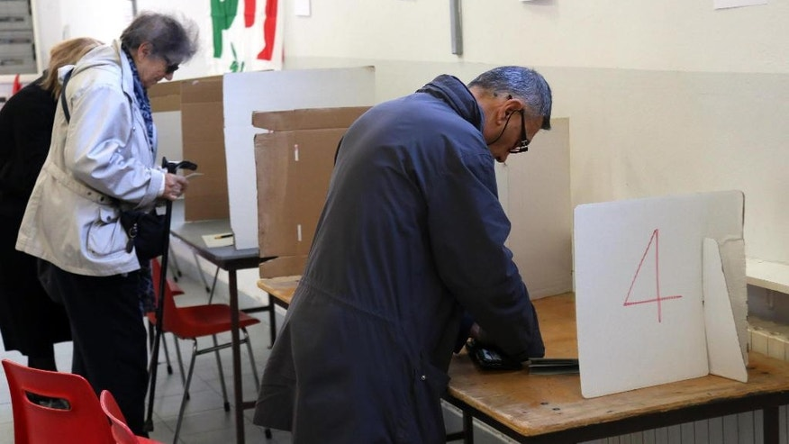 People vote for Democratic party's primary elections, in Bologna, Italy, Sunday, April 30, 2017. The three candidates are former Italian Premier Matteo Renzi, Governor of Apulia region, Michele Emiliano, and Justice Minister Andrea Orlando. (Giorgio Benvenuti/ANSA via AP)