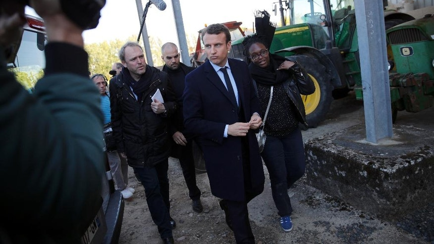 French centrist presidential candidate Emmanuel Macron visits a farm in Usseau, central France, Saturday, April 29 , 2017. Macron faces far-right presidential candidate Marine Le Pen in a May 7 runoff election. (AP Photo/Christophe Ena)