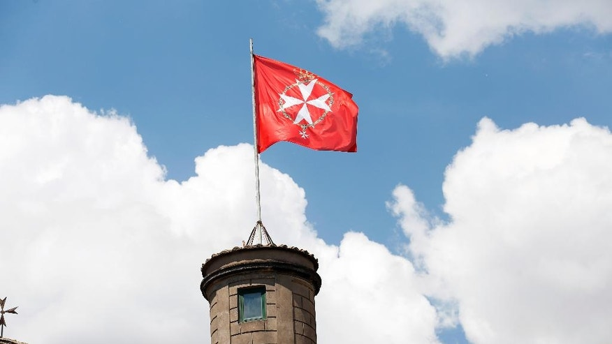 The Grand Master's flag waves after the election of Fra' Giacomo Dalla Torre, the Knights of Malta newly Lieutenant of the Grand Master, at the order's Villa Magistrale on Rome's Aventine Hill, Sunday, April 30, 2017. The ancient Knights of Malta religious order voted for a new leader after the old one was effectively ousted by Pope Francis. (Remo Camilli via AP)