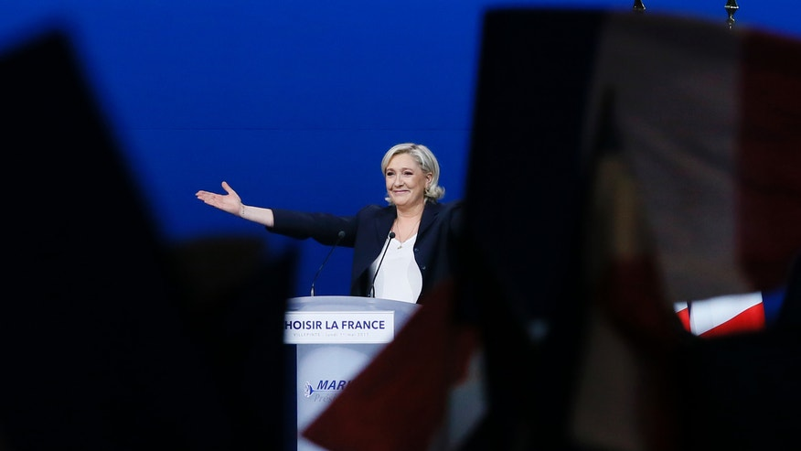 Le Pen aides brush off plagiarism of Fillon in French election speech