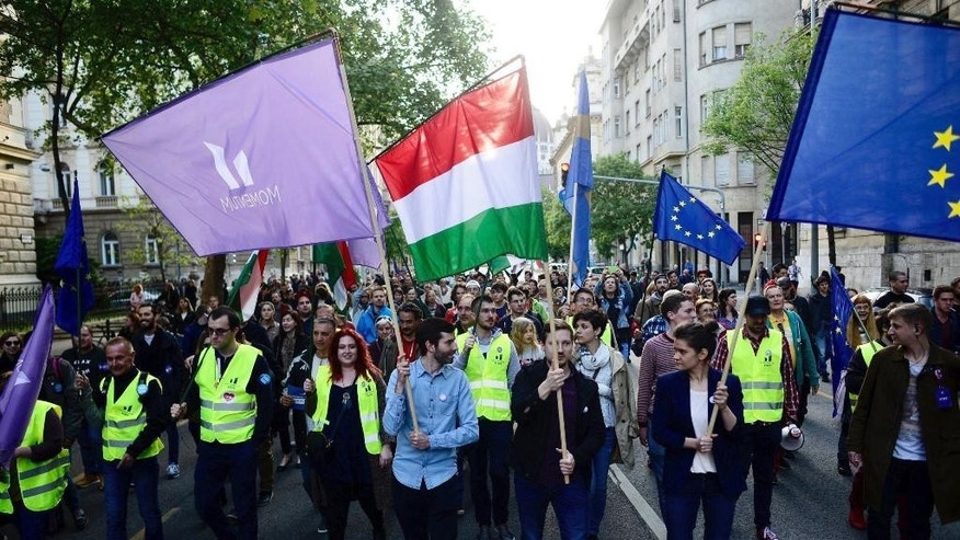 "Andras Fekete-Gyor, centre, chairman of the civic Momentum Movement and supporters attend the protest entitled ""We belong to Europe"" in central Budapest, Hungary, Monday, May 1, 2017. (Janos Marjai/MTI via AP)"