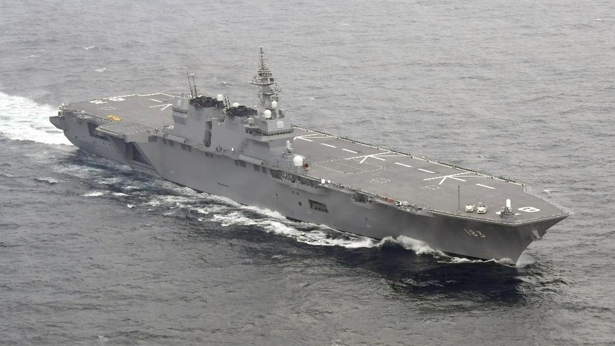Japan's helicopter carrier Izumo sails in the waters off the Boso Peninsula, east of Tokyo, as it starts to escort a U.S. supply ship after departing Yokosuka port, south of Tokyo, Monday, May 1, 2017. Japan's navy has dispatched its largest destroyer reportedly tasked with escorting U.S. military ships off the Japanese coast, a first-time mission under new security legislation that allows Japan's military a greater role overseas, amid heightened tension on the Korean Peninsula. (Ren Onuma/Kyodo News via AP)