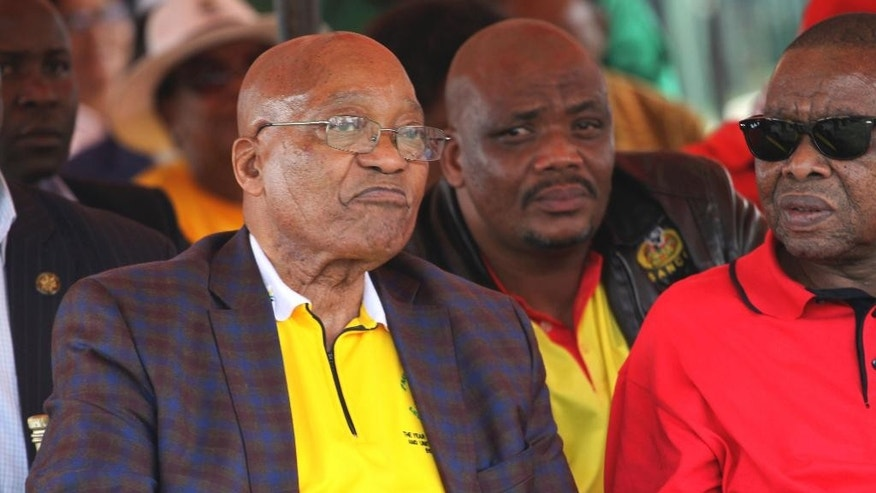 South African President Jacob Zuma, left, attends a May Day rally in Bloemfontein, South Africa, Monday, May 1, 2017. South African President Jacob Zuma was jeered by labor unionists and his speech was cancelled after scuffles broke out between his supporters and workers chanting for him to step down at the rally. (AP Photo/Khothatso Mokone)