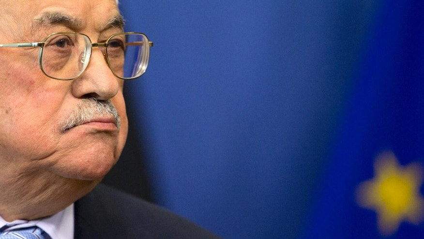 FILE -- In this March 27, 2017 file photo, Palestinian President Mahmoud Abbas listens during a media conference at EU headquarters in Brussels, Belgium. Abbas' initial relief over having been invited to the White House is now clouded by concerns that he will have to say no to President Donald Trump in their first meeting Wednesday, May 3, 2017. A key worry is that Trump will ask Abbas to halt monthly stipends for thousands of Palestinian security prisoners held by Israel, a seemingly untenable step at a time when a mass hunger strike has led to an outpouring of Palestinian popular support for the inmates. (AP Photo/Virginia Mayo, File)