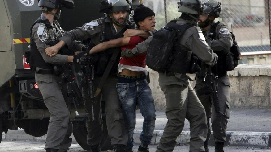 FILE -- In this Thursday April 27, 2017 file photo, Israeli border police arrest a Palestinian youth during clashes after a protest in support of Palestinian prisoners in Israeli jails, in Bethlehem, West Bank. Abbas' initial relief over having been invited to the White House is now clouded by concerns that he will have to say no to President Donald Trump in their first meeting Wednesday, May 3, 2017. (AP Photo/Mahmoud Illean, File)