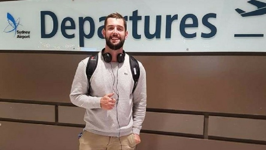 Baxter Reid, 26, was arrested on April 24 for reportedly overstaying his U.S. visa by 90 minutes, reports said. (GOFundMe)