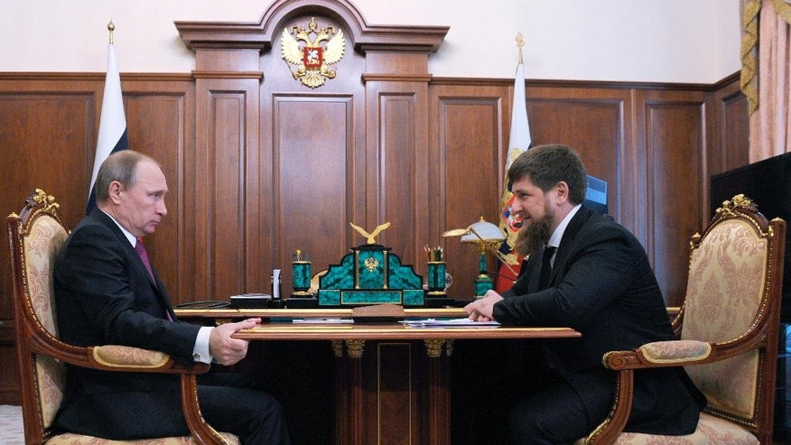 FILE - In this file photo taken on Friday, March 25, 2016, Russian President Vladimir Putin, left, meets with Chechen regional leader Ramzan Kadyrov in the Kremlin in Moscow, Russia. The leader of Chechnya says gay men do not exist in his republic and dismisses reports that 100 gay men have been rounded up, tortured and sometimes killed. (Mikhail Klimentyev, Sputnik, Kremlin Pool Photo via AP, File)