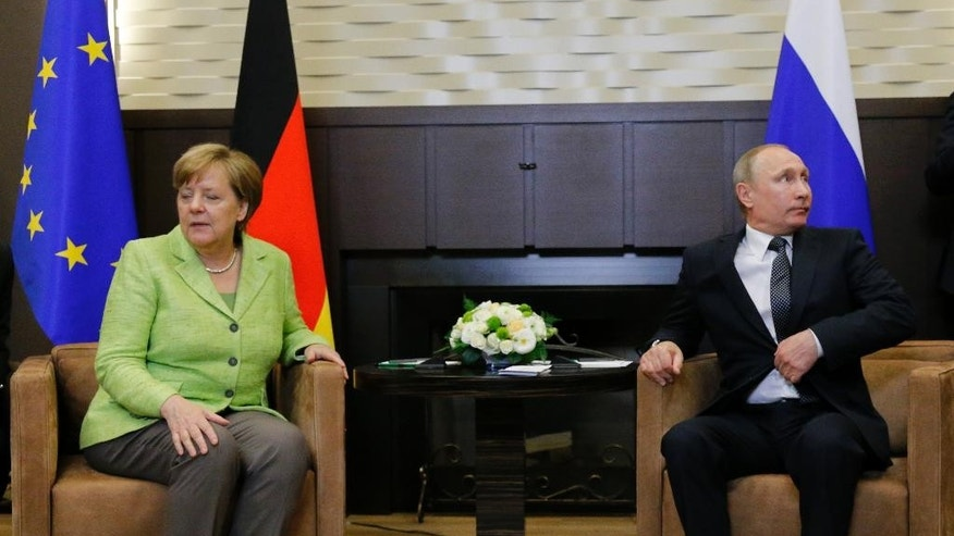 Russian President Vladimir Putin, right, and German Chancellor Angela Merkel prepare for talks at Putin's residence in the Russian Black Sea resort of Sochi, Russia, Tuesday, May 2, 2017. German Chancellor Angela Merkel has arrived in Russia for talks with President Vladimir Putin expected to focus on the unresolved conflict in Ukraine and the civil war in Syria. (AP Photo/Alexander Zemlianichenko, Pool)