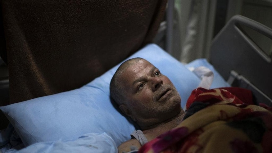 Ali Zanoun, one of the only survivors of a U.S. strike on a building in Mosul, lies on his bed as he waits for another surgery at a hospital in Irbil, Iraq, in this photo from Saturday, April 8, 2017. Zanoun was trapped for five days under the rubble of the building after the March 17 strike, which killed more than 100 people and was the deadliest single incident in the months-long Iraqi campaign to retake the northern Iraqi city. (AP Photo/Felipe Dana)