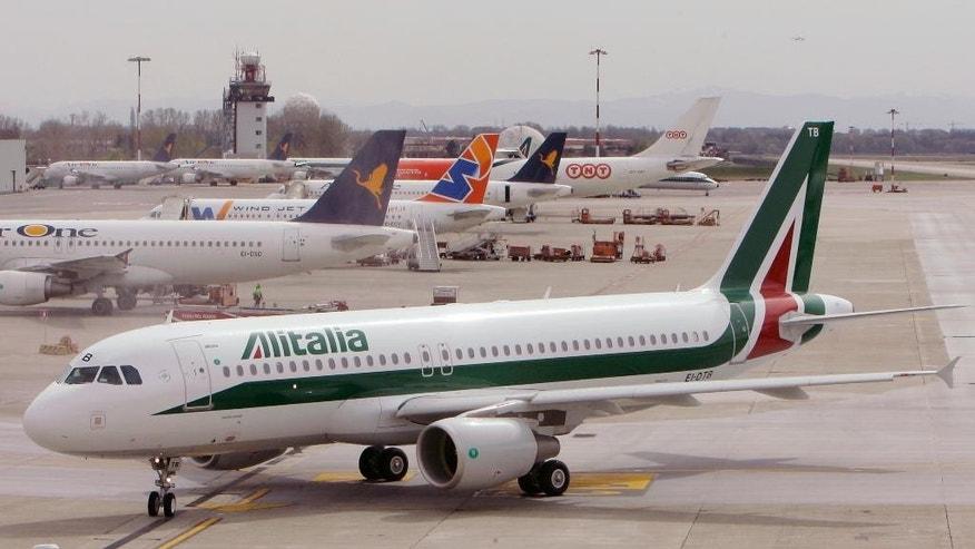 "FILE - In this March 25, 2009 file photo, an Alitalia Airbus A320 is parked at the Linate airport in Milan, Italy. Italy's struggling flagship airline, Alitalia, headed toward its second period of receivership in a decade on Tuesday, May 2, 2017 with the board of directors saying it had no choice after workers overwhelmingly rejected a relaunch plan that would have unlocked new investments. The board expressed ""deep regret"" that workers had voted against the government-brokered relaunch plan, which had softened planned job and salary cuts but was criticized for not having realistic strategy for reviving revenue. (AP Photo/Antonio Calanni, File)"
