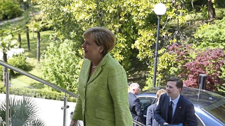 German Chancellor Angela Merkel, left, arrives in Russian President Vladimir Putin's residence in the Russian Black Sea resort of Sochi, Russia, Tuesday, May 2, 2017. German Chancellor Angela Merkel has arrived in Russia for talks with President Vladimir Putin expected to focus on the unresolved conflict in Ukraine and the civil war in Syria. (Yuri Kochetkov/ Pool photo via AP)