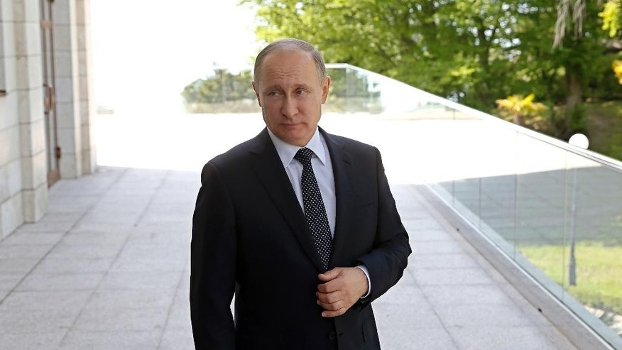 Russian President Vladimir Putin waits for German Chancellor Angela Merkel prior to their talks at Putin's residence in the Russian Black Sea resort of Sochi, Russia, Tuesday, May 2, 2017. German Chancellor Angela Merkel has arrived in Russia for talks with President Vladimir Putin expected to focus on the unresolved conflict in Ukraine and the civil war in Syria. (Yuri Kochetkov/ Pool photo via AP)