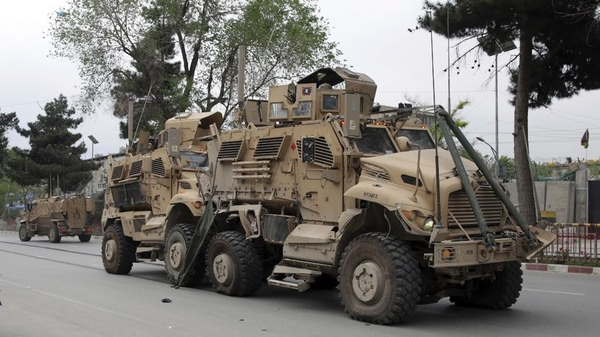 A damaged U.S. military vehicle is pictured at the site of a suicide attack in Kabul, Afghanistan, Wednesday, May 3 , 2017. Najib Danish, deputy spokesman for the Interior Ministry, said Wednesday the target of the bomber was a convoy of foreign forces. (AP Photos/Massoud Hossaini)
