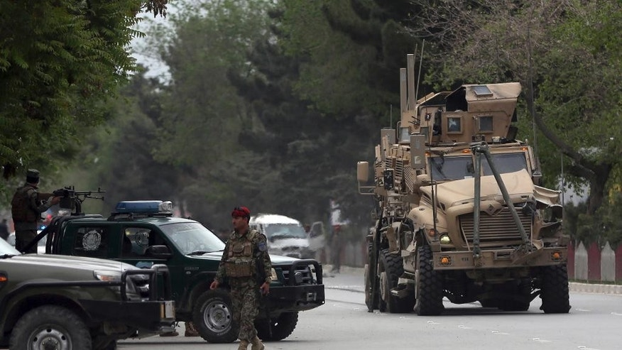 A damaged US military vehicle is being pulled near the site of a suicide attack in Kabul, Afghanistan, Wednesday, May 3 , 2017. Afghan officials say that at least four people have been killed in a suicide car bomb attack in the capital Kabul. (AP Photos/Massoud Hossaini)