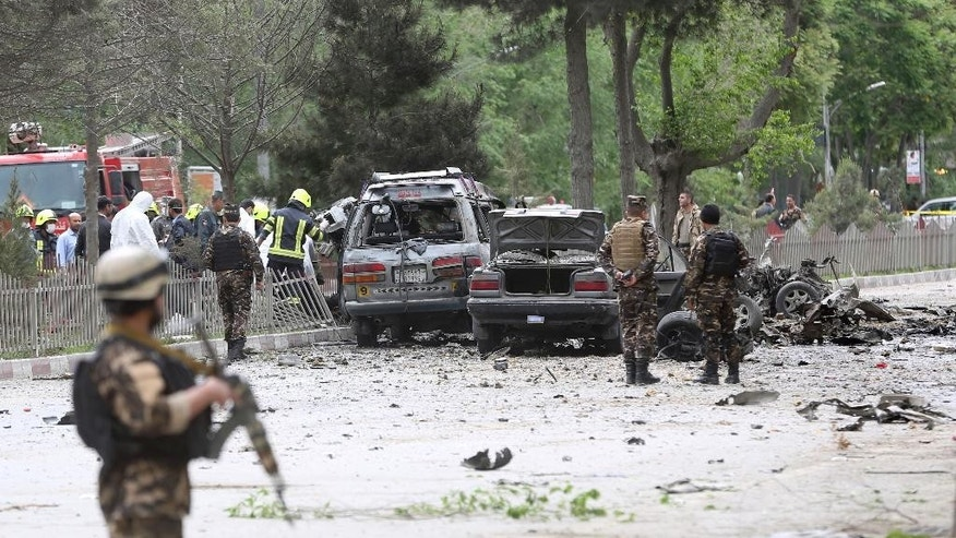 Security forces inspect at the site of a suicide attack in Kabul, Afghanistan, Wednesday, May 3 , 2017.  Afghan officials say that at least four people have been killed in a suicide car bomb attack in the capital Kabul. (AP Photos/Massoud Hossaini)
