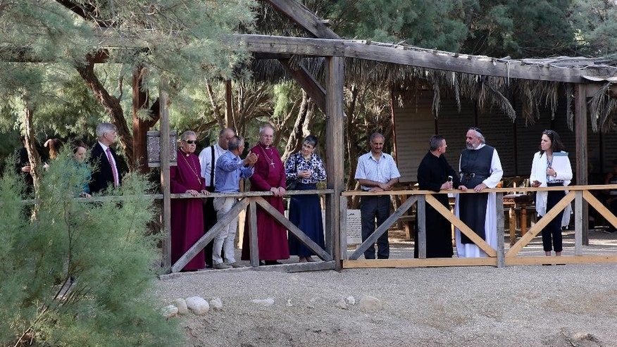 "The Archbishop of Canterbury, Justin Welby, center left, visits the archaeological site al-Maghtas in Jordan Wednesday. May, 3, 2017. During the prayer he said ""in this place where we hear birdsong and running water we are surrounded within a few kilometers with violence."" The head of the Anglican church was on a visit to the region to meet refugees including Christians from Iraq and King Abdullah II. He pledged support for the refugees in Europe as well as in the Middle East. (AP Photo/Sam McNeil)"