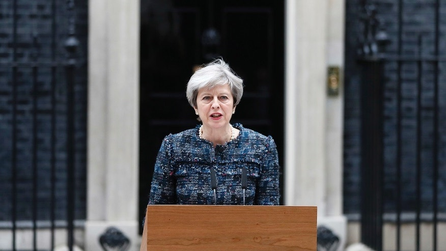 British Prime Minister Theresa May speaks to the media outside 10 Downing Street after returning from visiting Queen Elizabeth II at Buckingham Palace, in London where she asked for the dissolution of Parliament ahead of the upcoming general election, Wednesday, May 3, 2017. (AP Photo/Kirsty Wigglesworth)