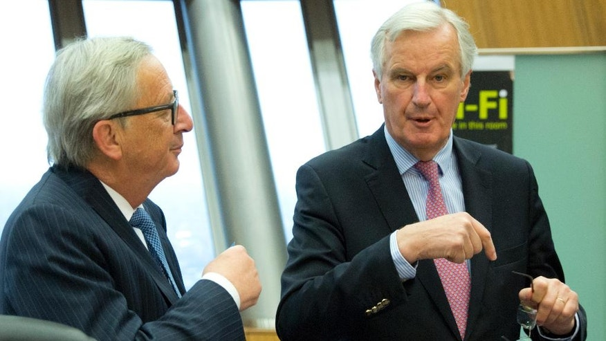 European Union chief Brexit negotiator Michel Barnier, right, speaks with European Commission President Jean-Claude Juncker during a weekly EU Commission meeting at EU headquarters in Brussels on Wednesday, May 3, 2017. The EU's chief Brexit negotiator, Michel Barnier, will speak to the media in Brussels on Wednesday regarding Britain's departure from the bloc, after he presents his draft mandate laying out the terms for the talks. (AP Photo/Virginia Mayo)